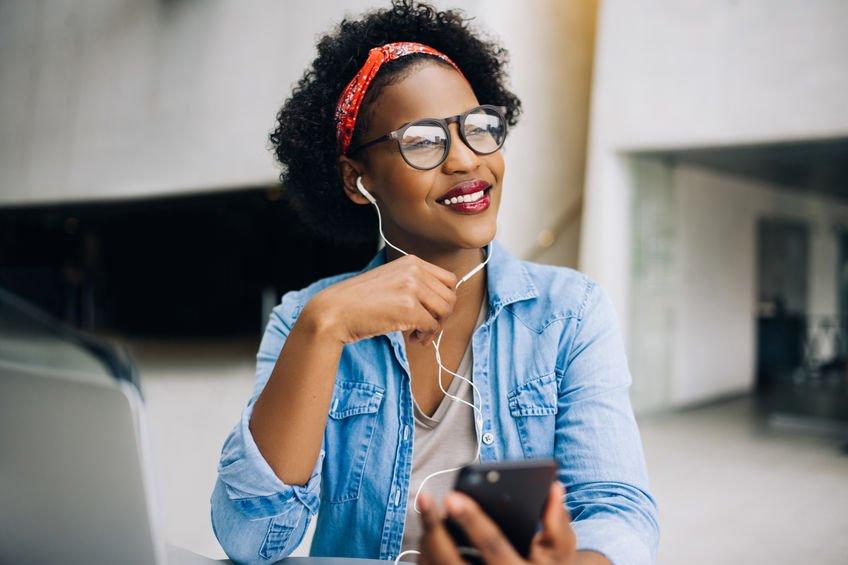 African female entrepreneur listening to music